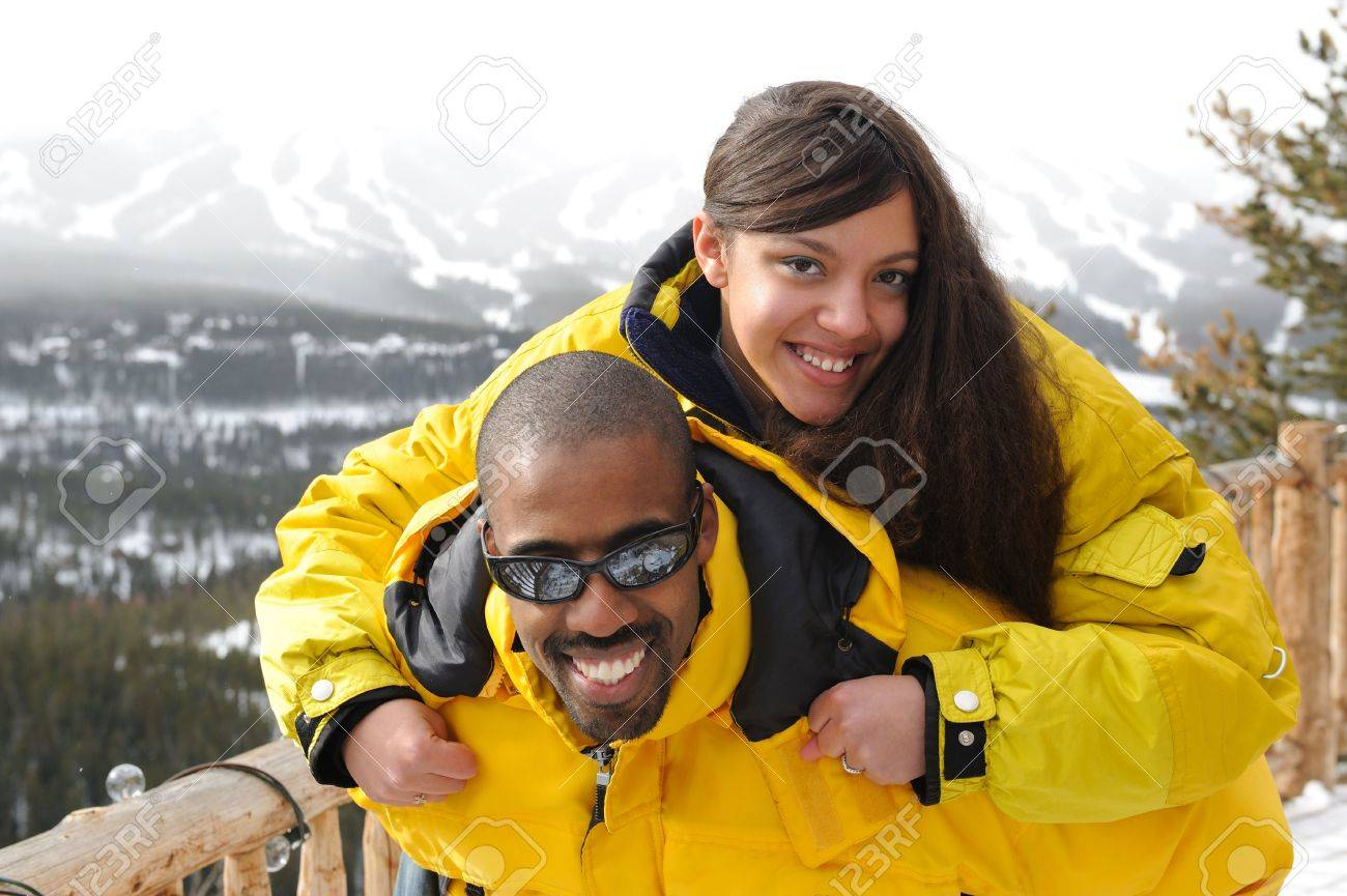 african american family at ski resort stock photo, picture and