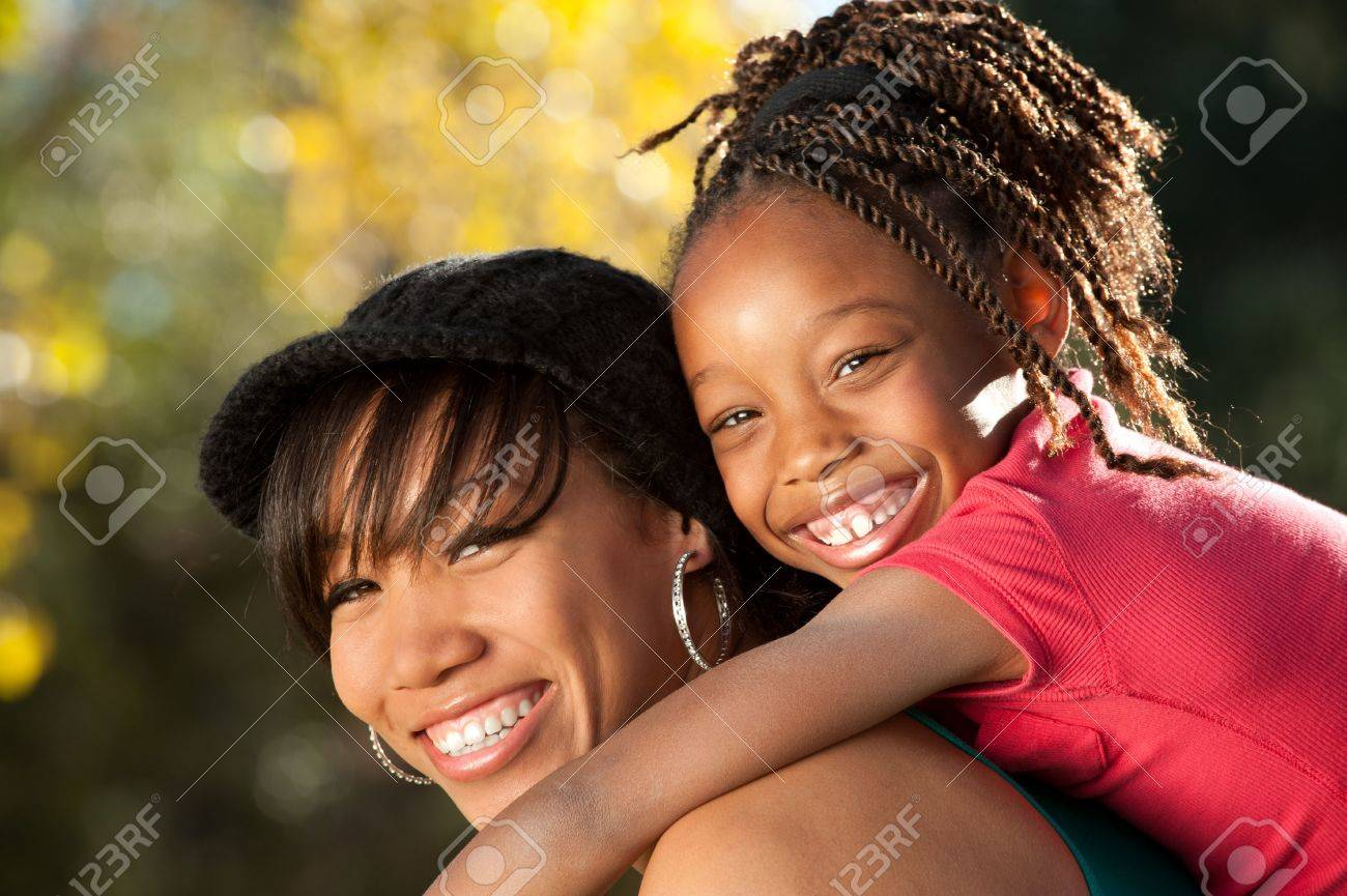 Happy African American mother and child having fun spending time together in a park Stock Photo - 8225111