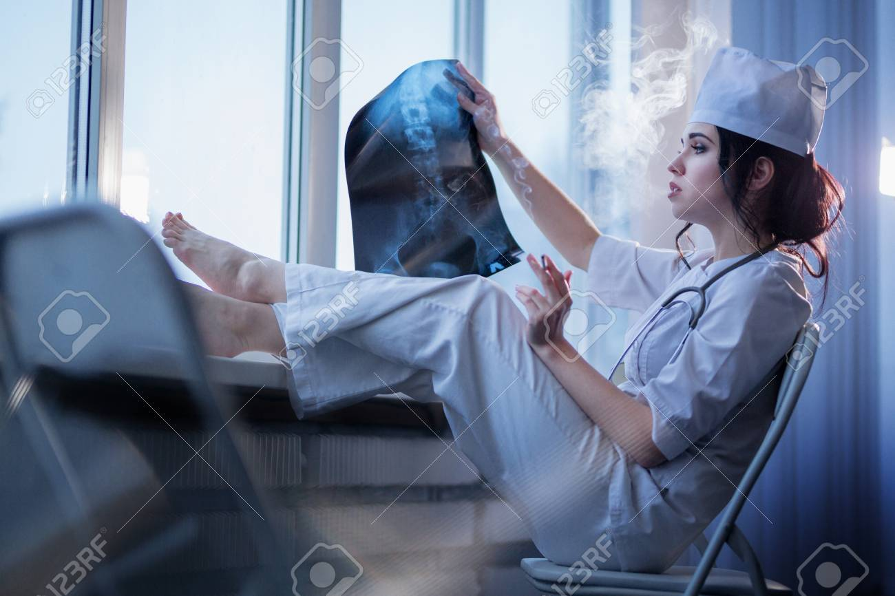 https://previews.123rf.com/images/studio2sim/studio2sim1706/studio2sim170600005/79412023-brunette-sassy-female-nurse-in-uniform-smoking-a-cigarette-and-looking-at-x-ray-picture-of-backbone.jpg