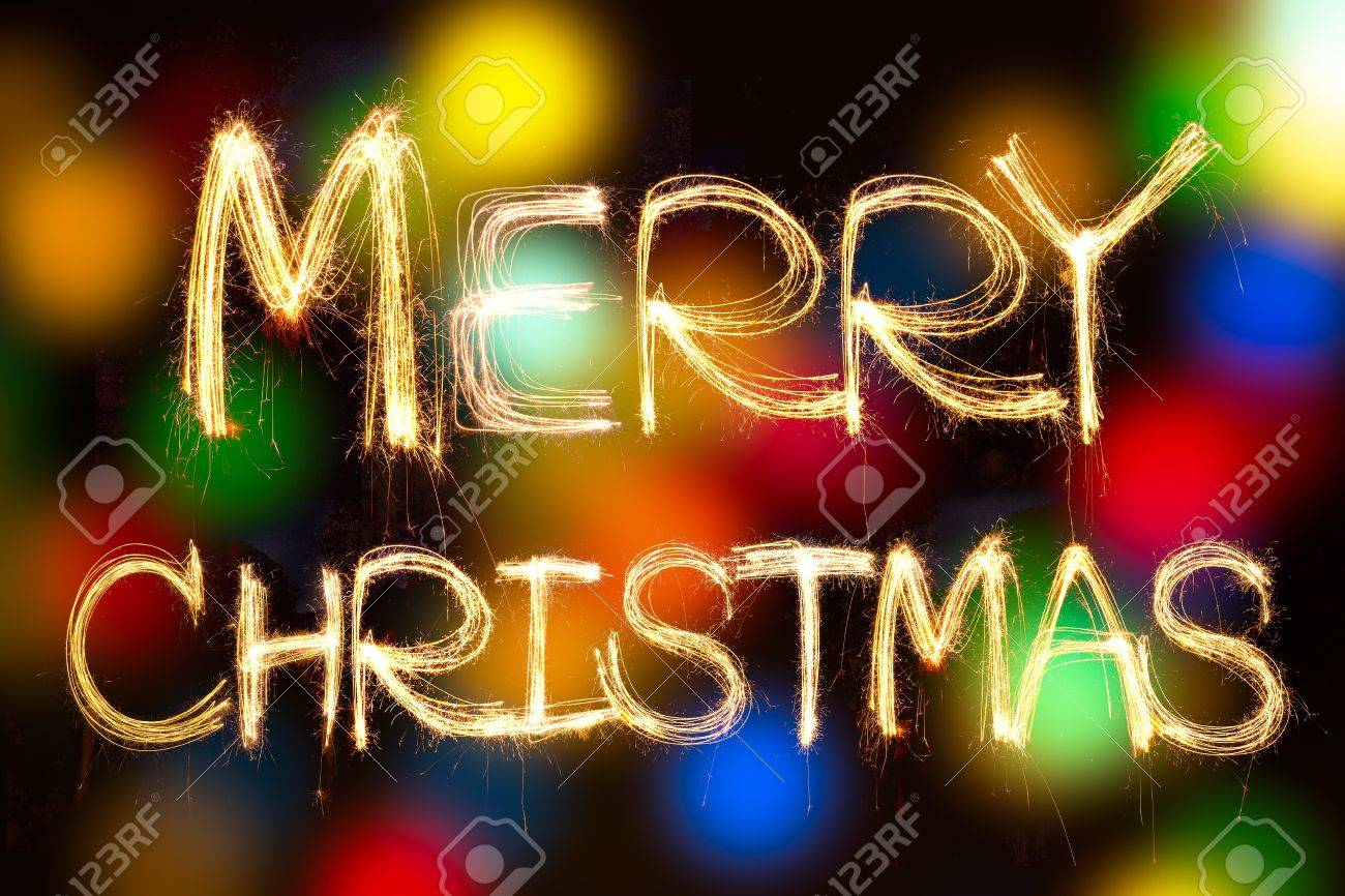 merry christmas written with Sparkling figures  on bokeh background Stock Photo - 16697341