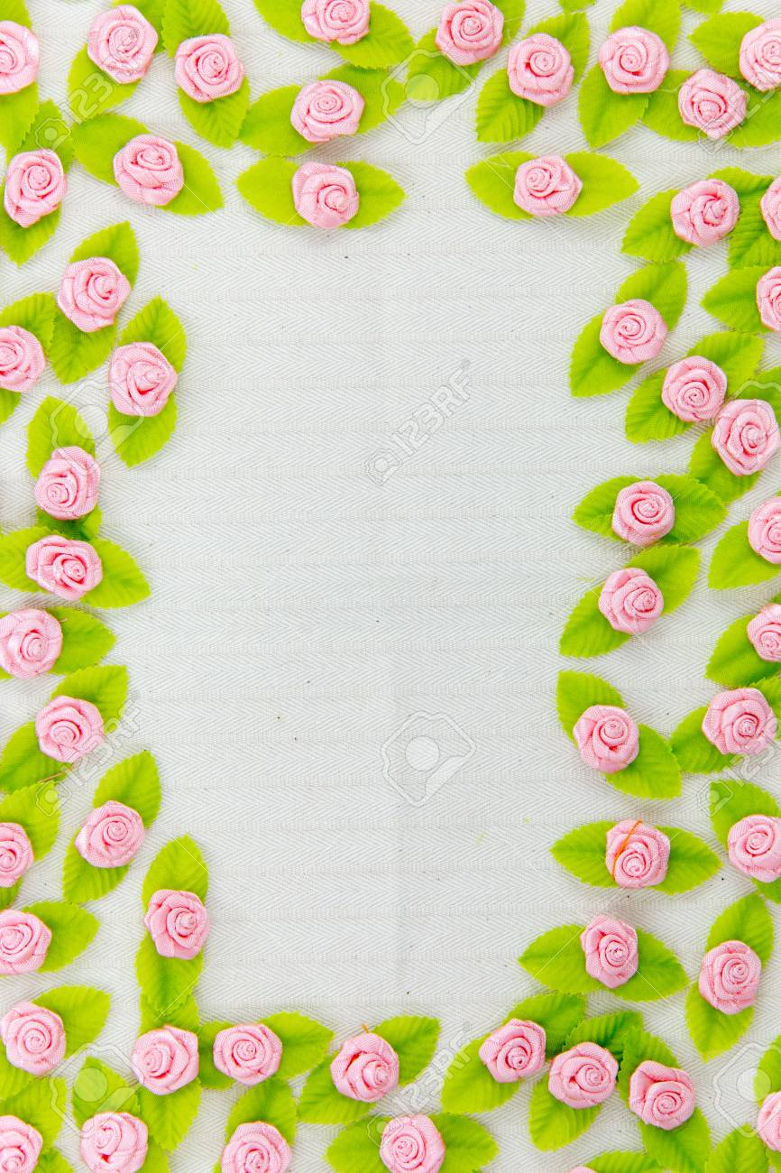 A border made of fabric flower isolated on a white background Stock Photo - 17469142