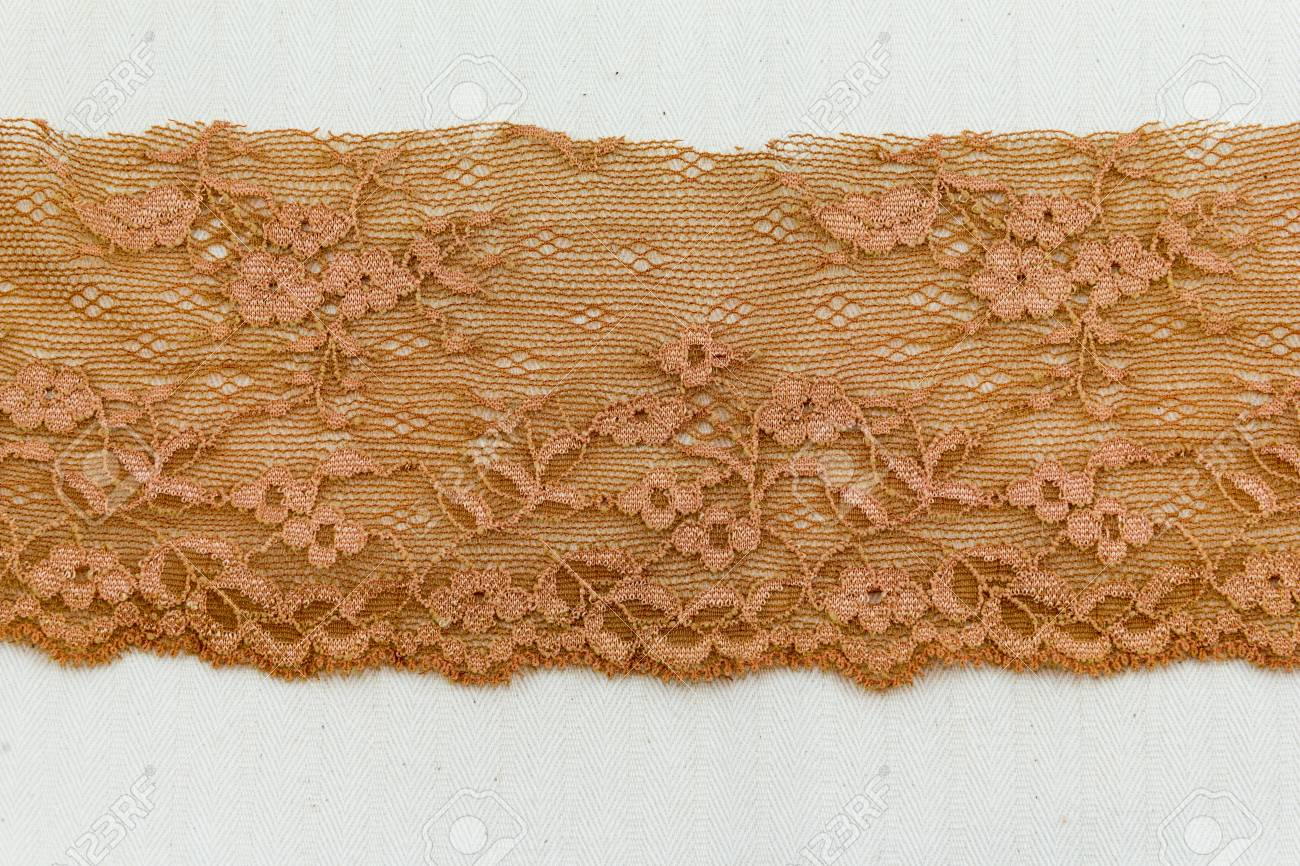 Lace flowers frame close up isolated on Fabric texture Stock Photo - 17469159