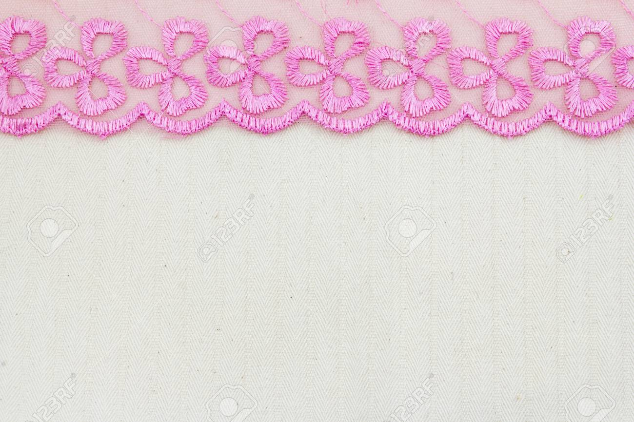 Lace flowers frame close up isolated on Fabric texture Stock Photo - 17469082