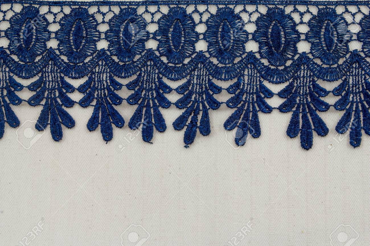 Lace flowers frame close up isolated on Fabric texture Stock Photo - 17469163