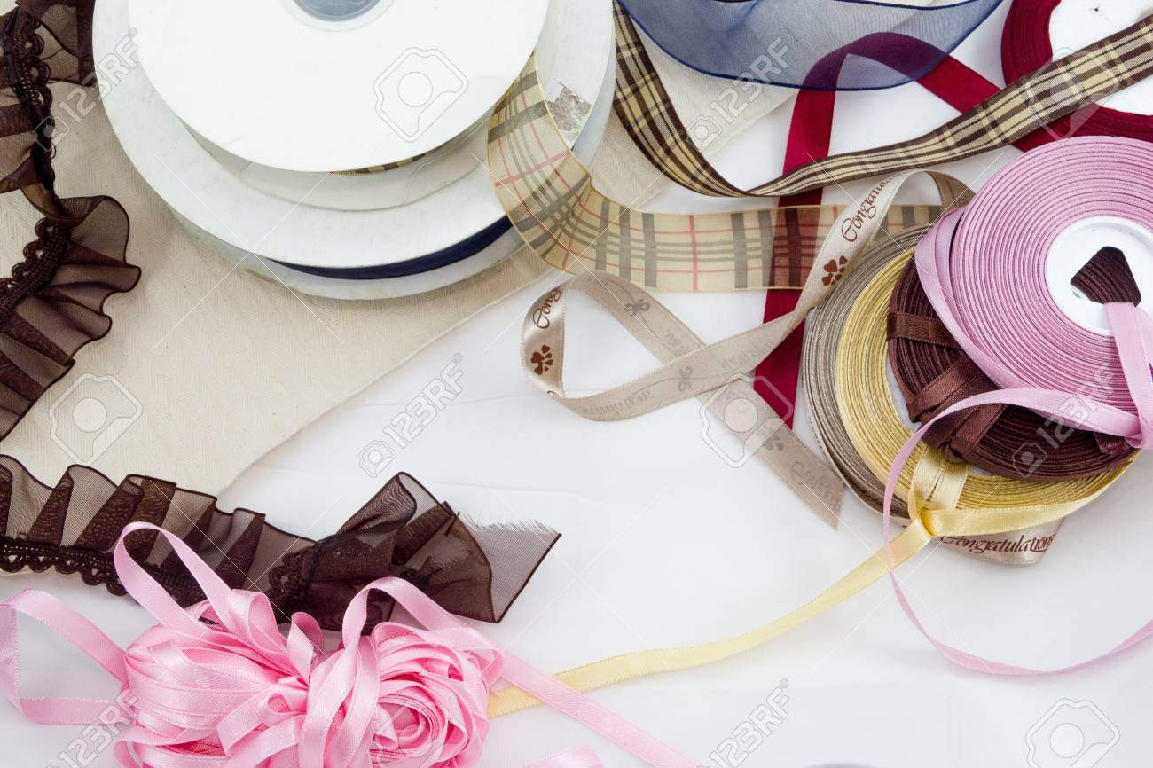many-coloured  satin ribbons spools in the craft Stock Photo - 17469044