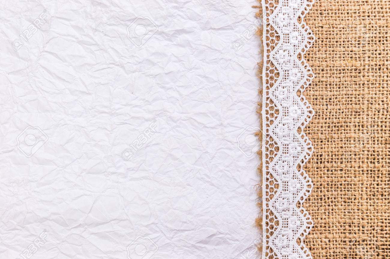 Close Up Of Lace Flowers Frame And Burlap Over Paper Texture Design For Border Or Background