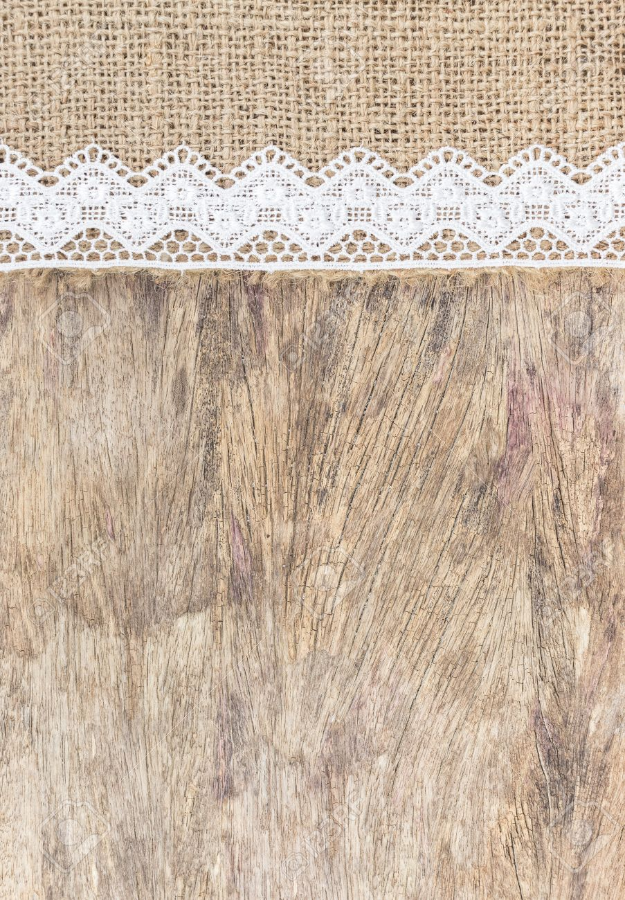 Burlap Texture With White Lace On Wooden Table Background Design For Stock Photo