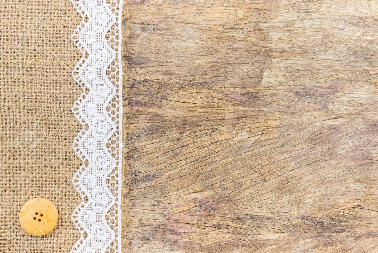 Burlap Texture With White Lace On Wooden Table Background Design For Stok Fotograf