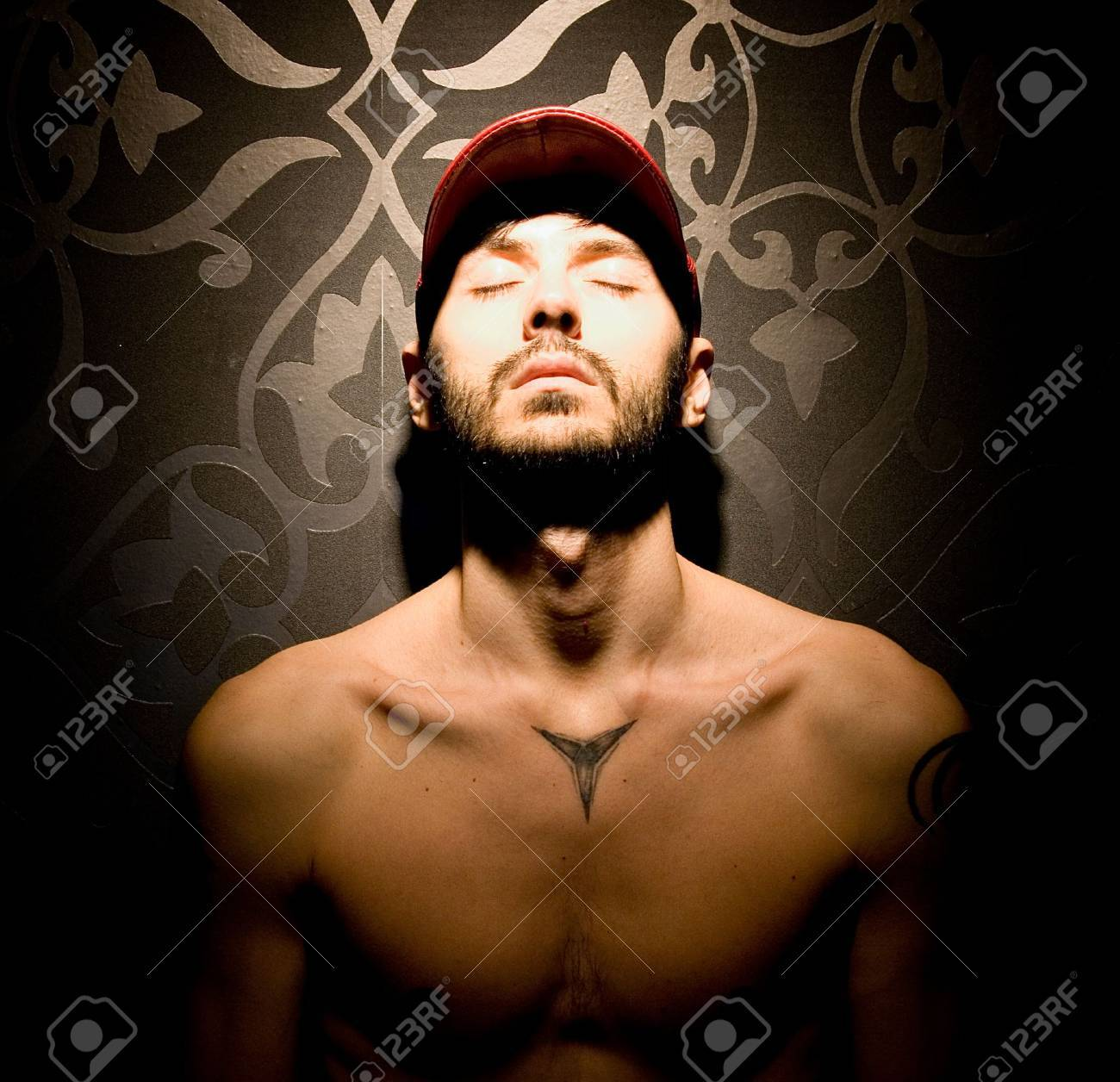 Model with red hat , without shirt in the spotlight Stock Photo - 14903734