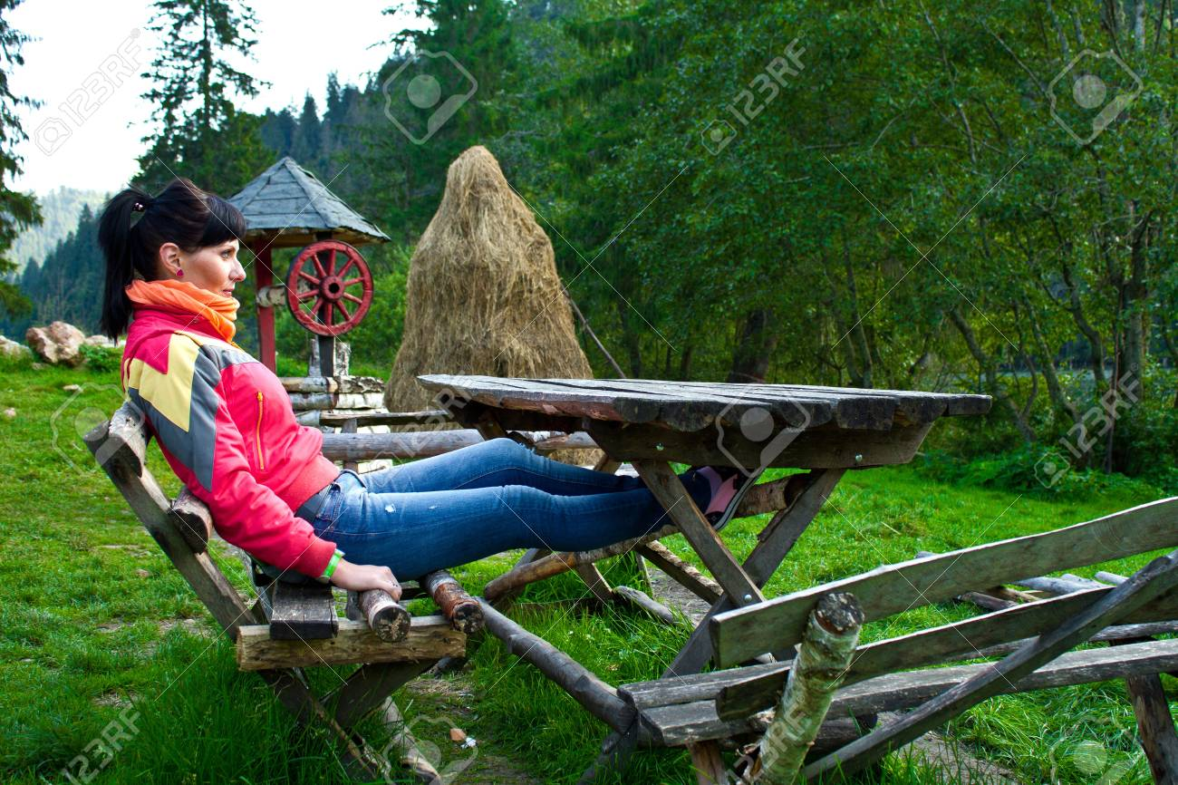 Woman sitting on a bench near the lake Stock Photo - 15360508