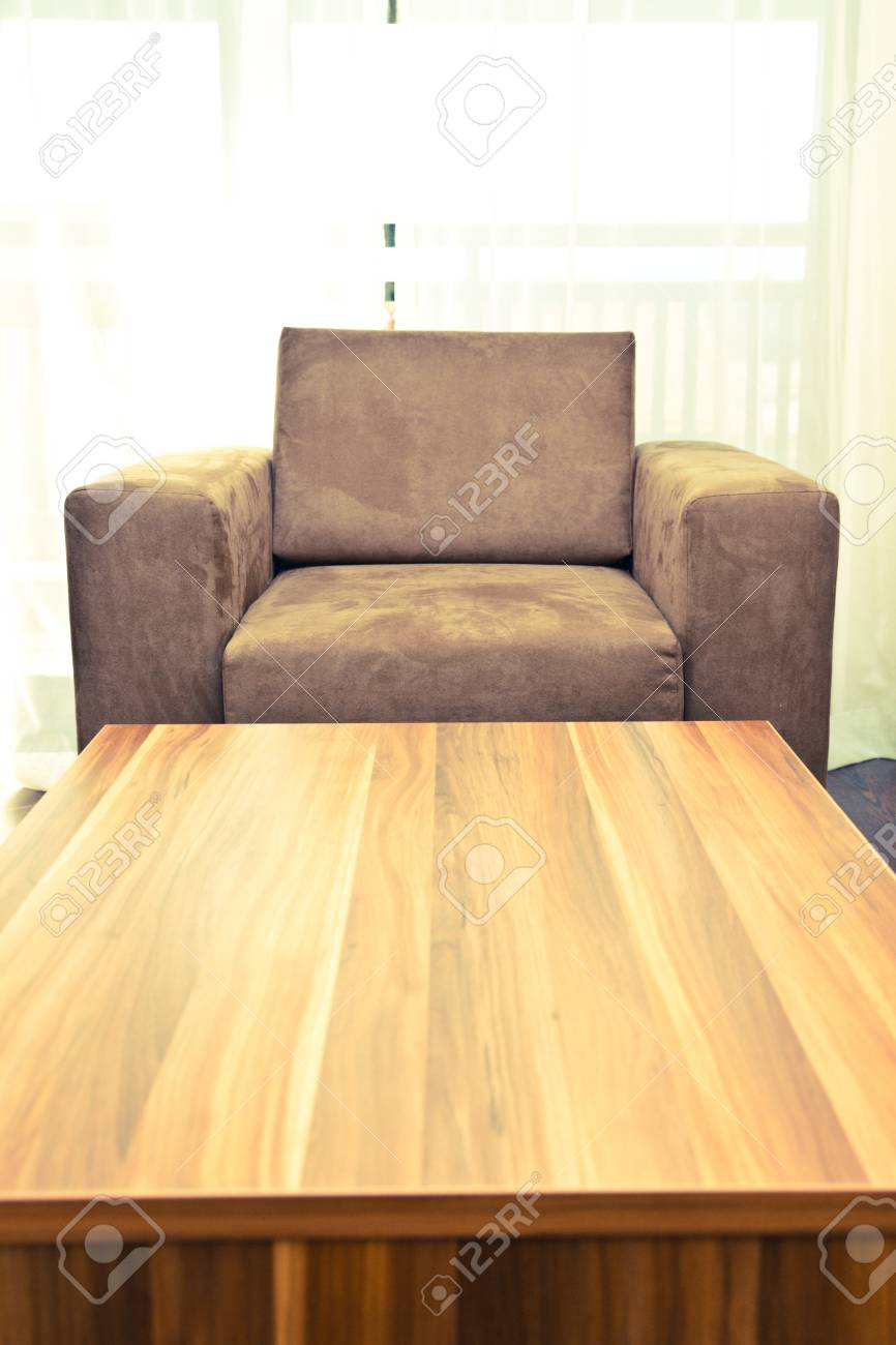 Brown armchair with wooden table in front Stock Photo - 15409289