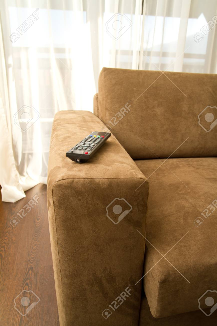 Brown armchair in front of the window Stock Photo - 15409274