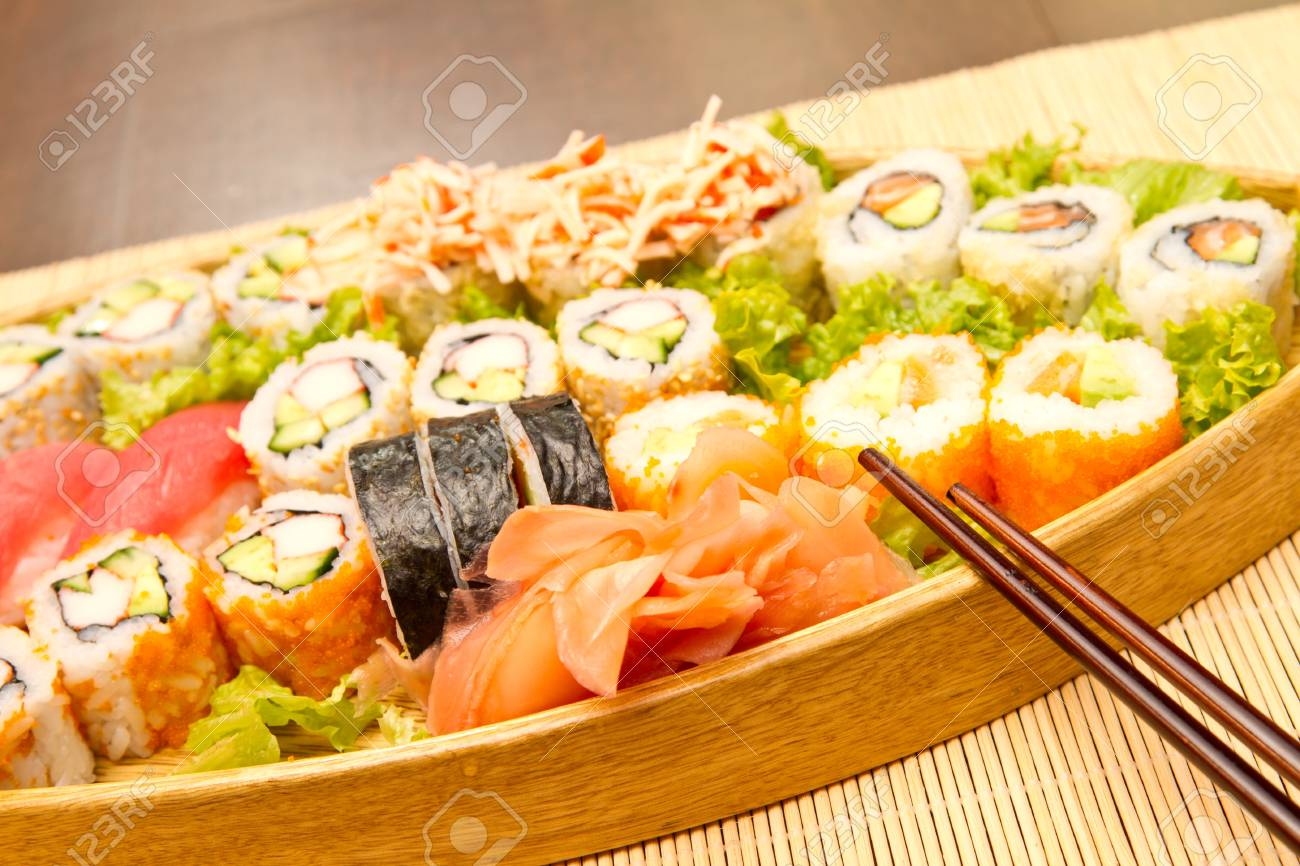 Different kinds of sushi on a wooden plate Stock Photo - 15861795