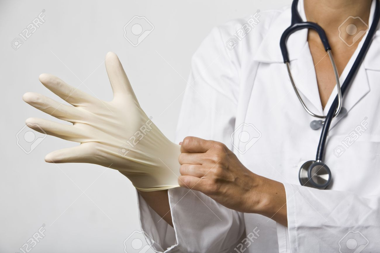 Doctor pulls on a latex glove. Stock Photo - 6140042