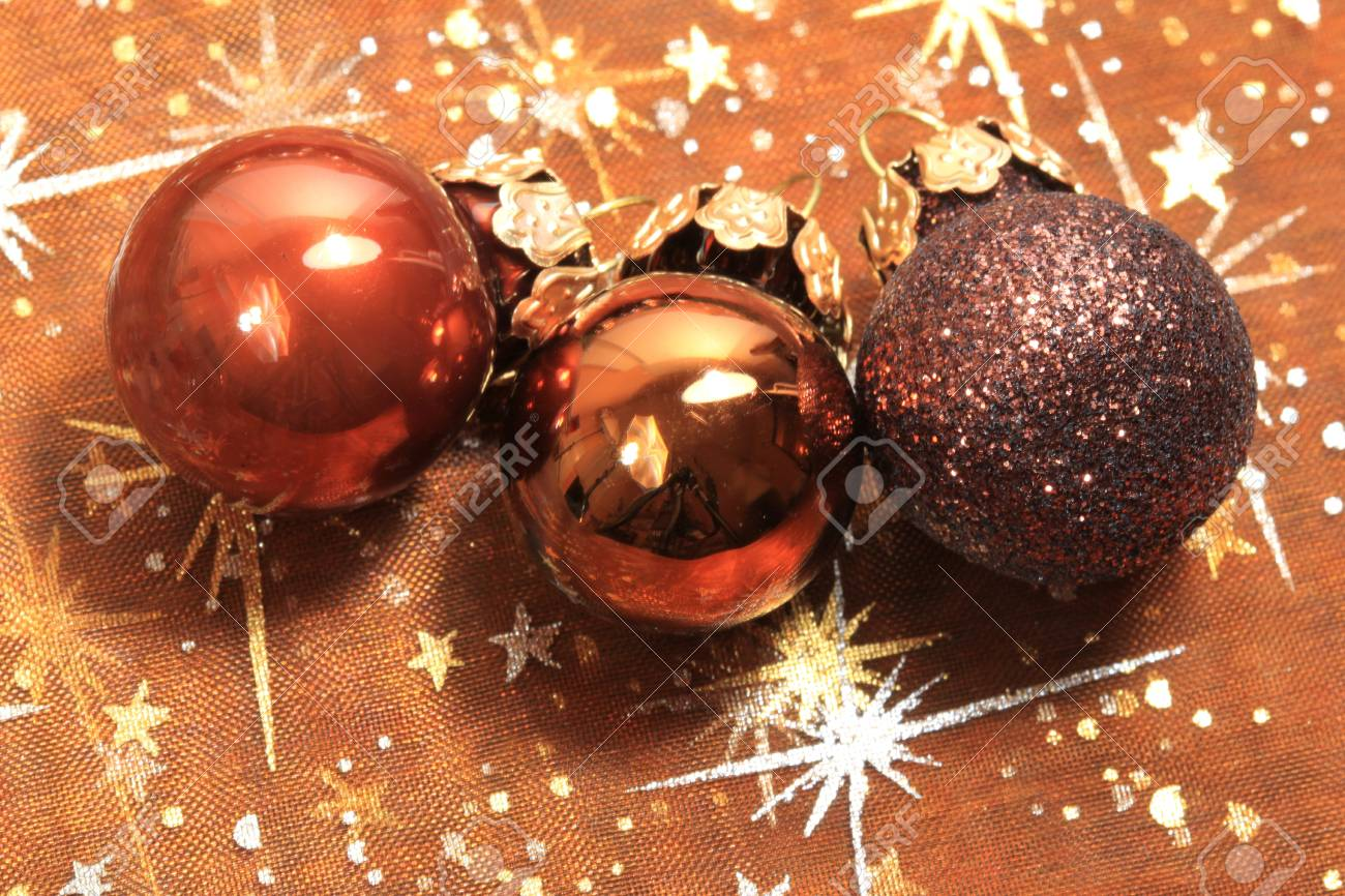 Three brown shiny Christmas glass balls Stock Photo - 8418176