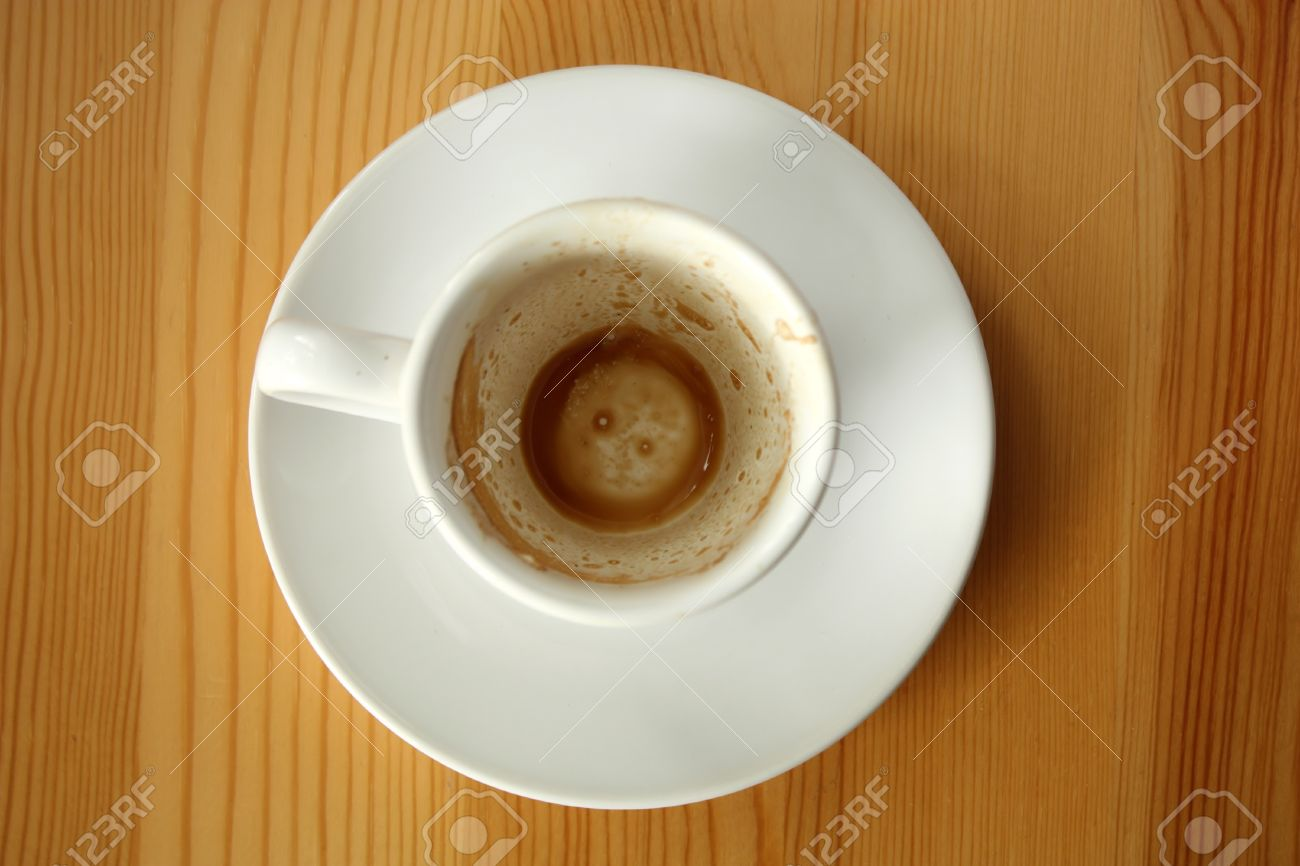 Empty white cup after espresso coffee - top view Stock Photo - 10083074