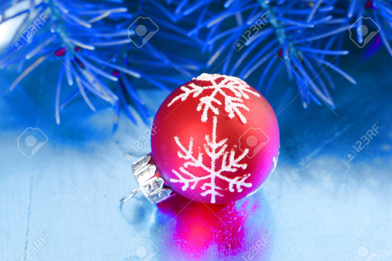 Red Glass Christmas Bauble On Blue Table Decoration Stock Photo
