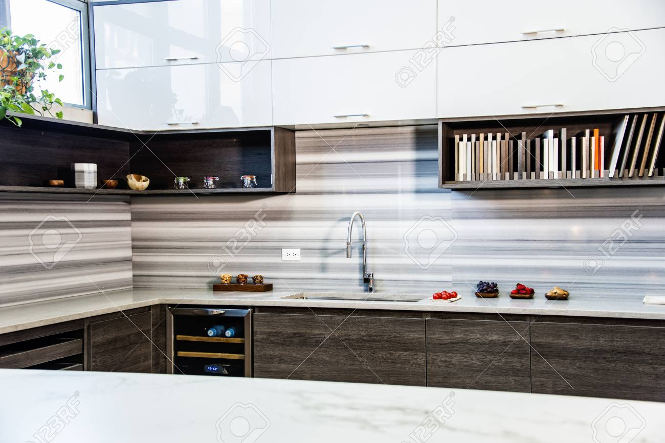 Brown Wood Kitchen Cabinets With Full Granite Countertop Backsplash Stock Photo Picture And Royalty Free Image Image 76911509