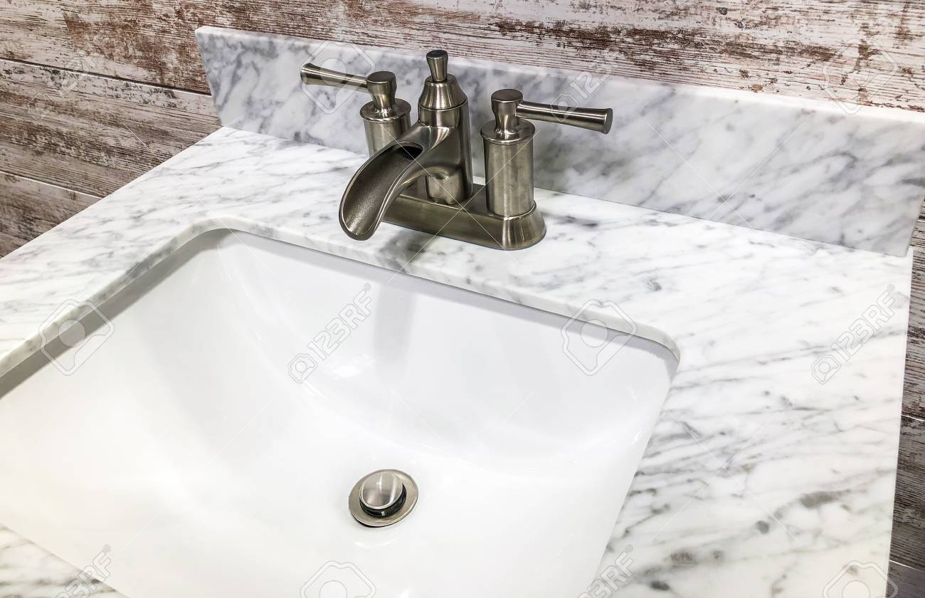 Bathroom Sink With White And Gray Granite Cointertop And Vintage Look Faucet With White And Gray Backsplash Stock Photo Picture And Royalty Free Image Image 113376647