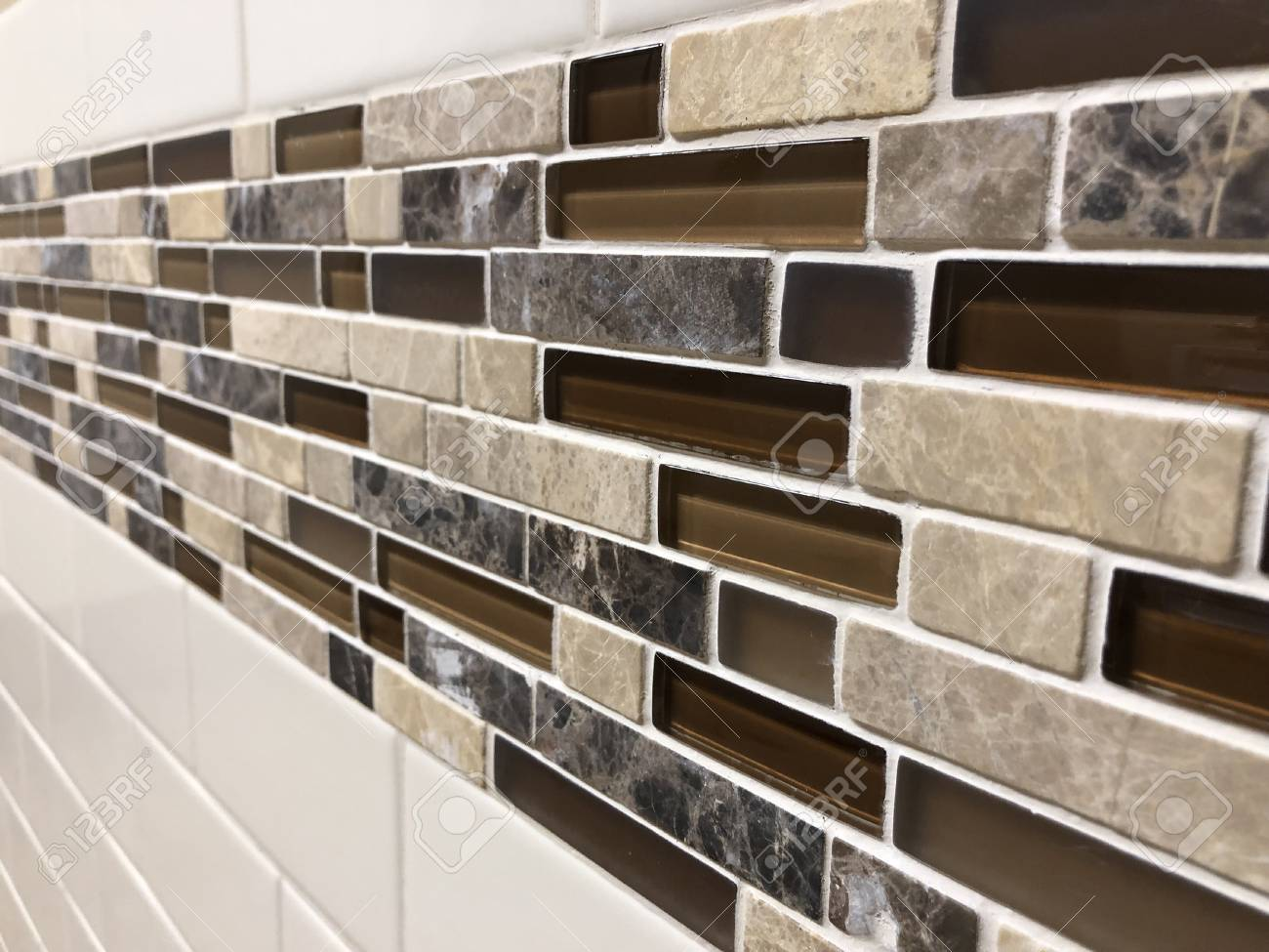 Beautiful glass and ceramic tiles in various sizes installed..