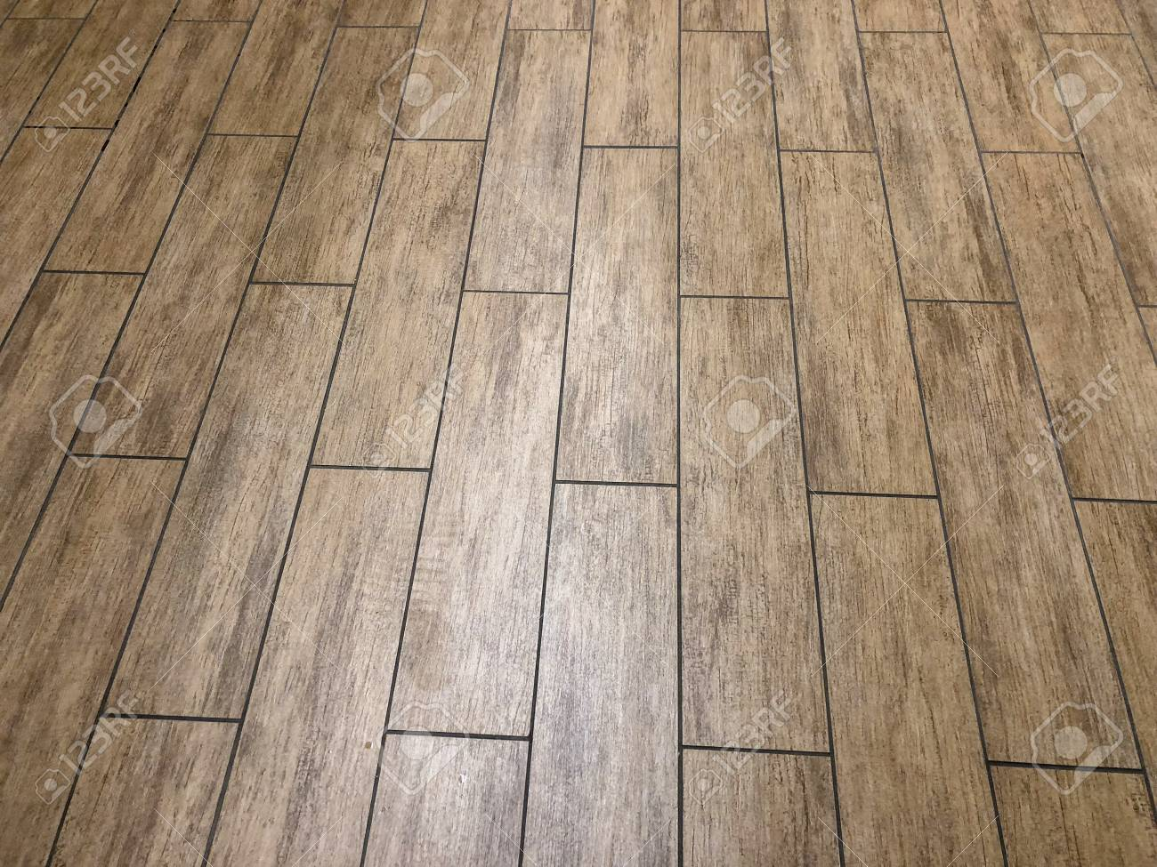modern slate or ceramic long tiles installed in staggered pattern - 125499348