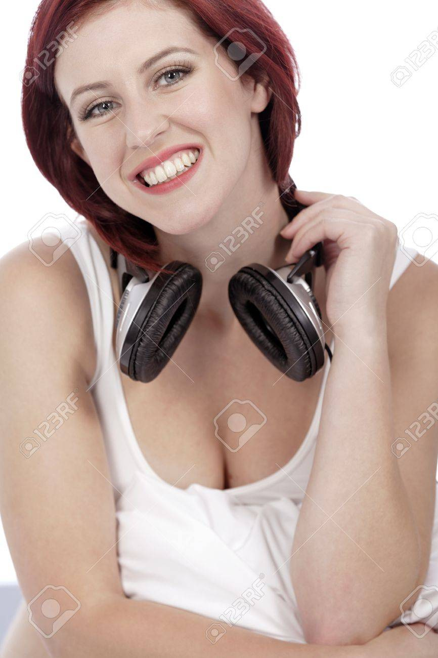 Attractive young woman listening to music at home on her bed Stock Photo - 15442971