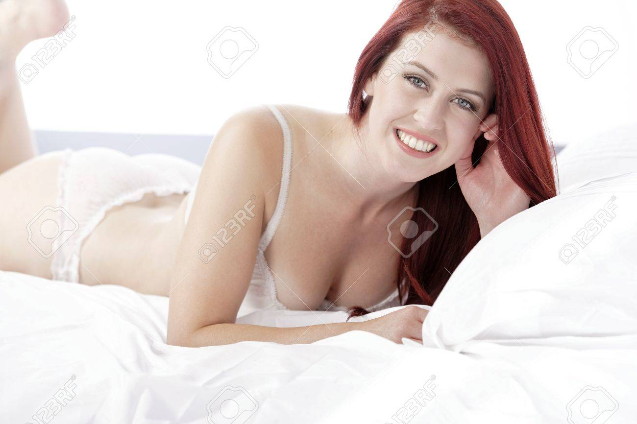 Beautiful young woman resting on her bed at home in her underwear Stock Photo - 15465822
