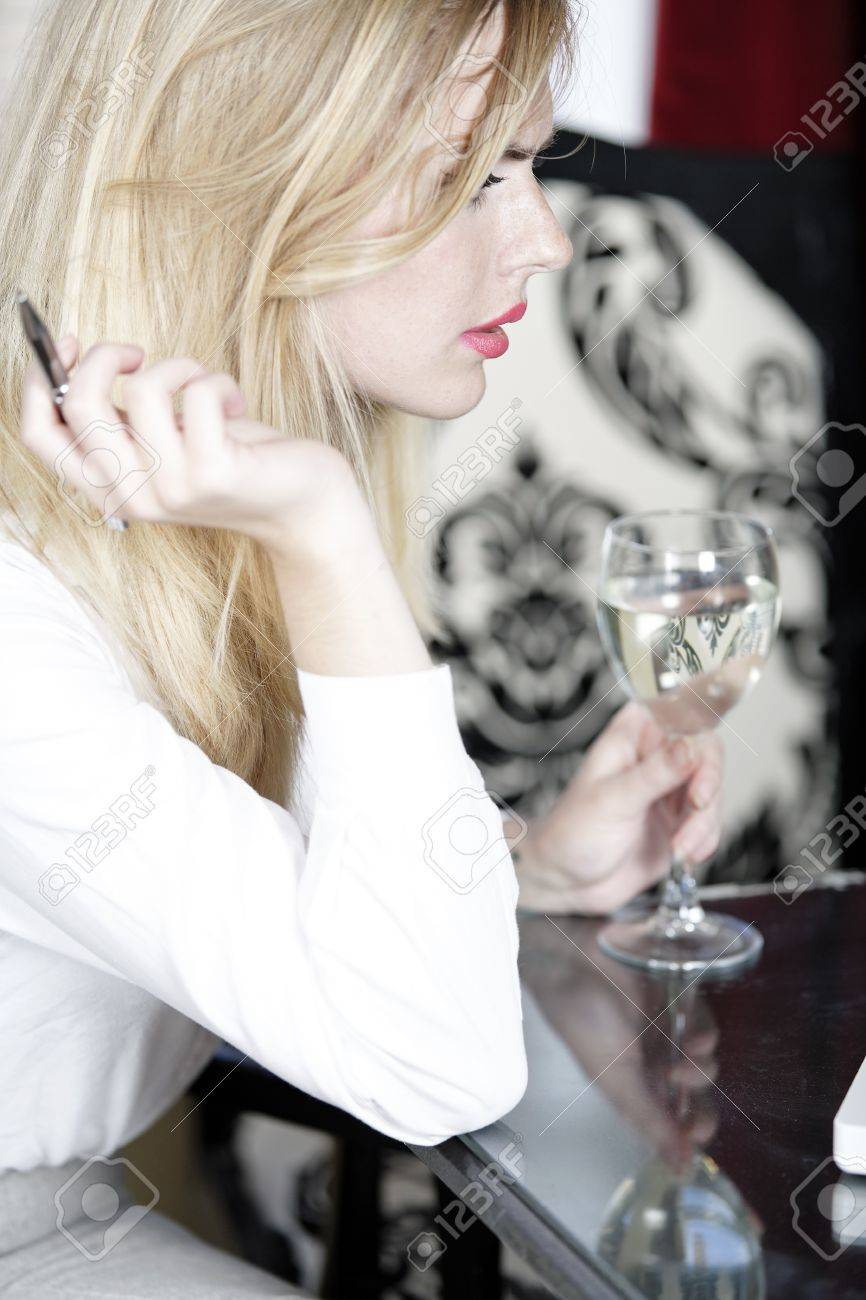 Woman in wine bar reading and expressing concern. Stock Photo - 16217684