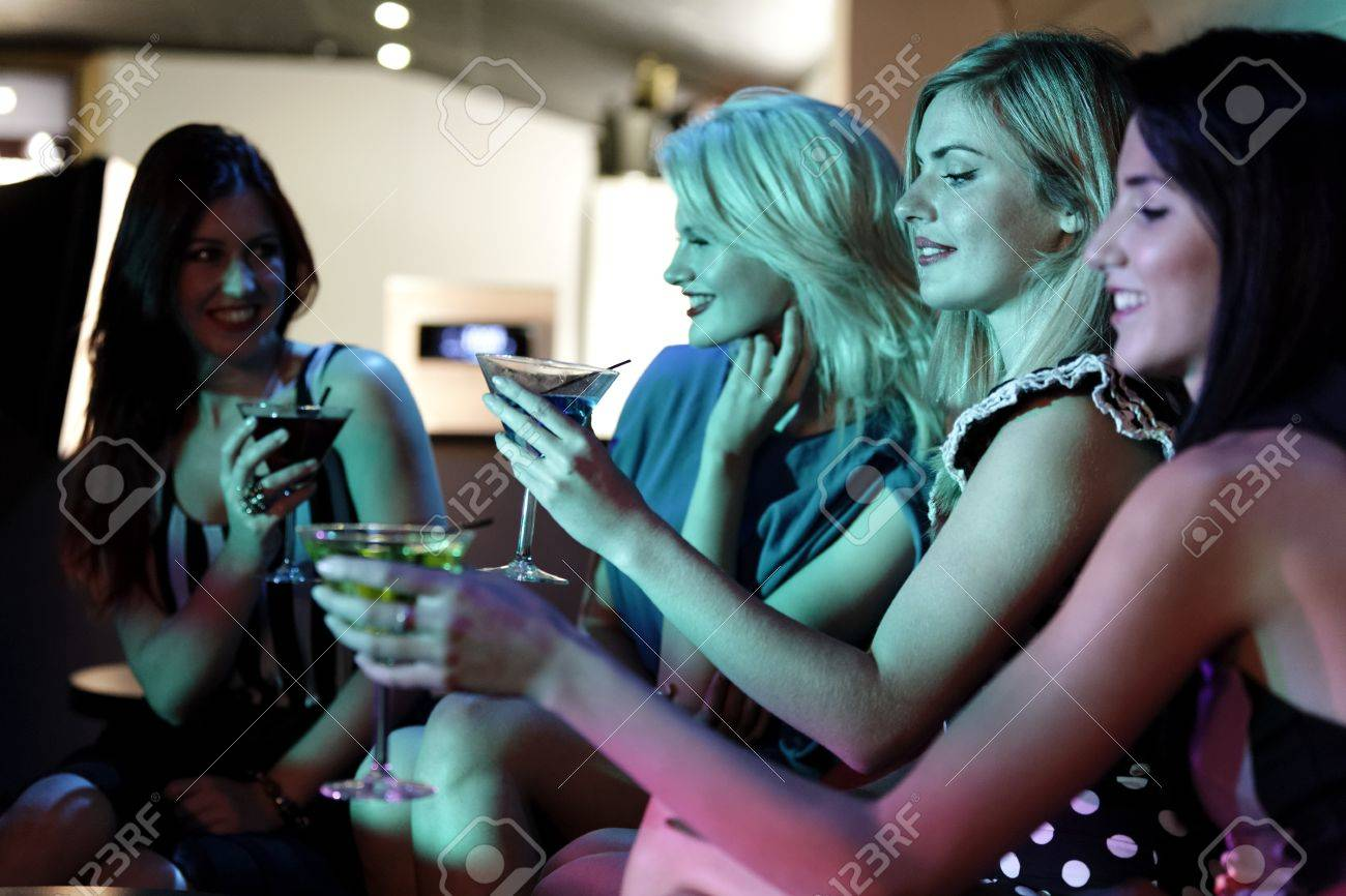 Attractive group of friends laughing and having fun in a nightclub Stock Photo - 18000745