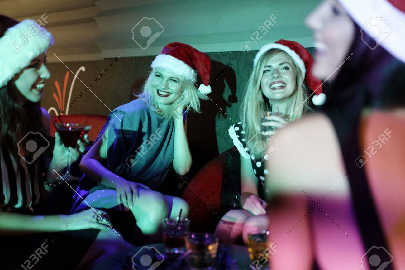 Attractive group of friends laughing and having fun at a Christmas party Stock Photo - 18000708