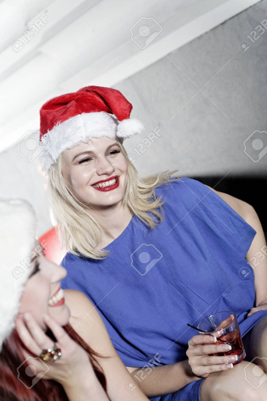 Attractive group of friends laughing and having fun at a Christmas party Stock Photo - 18000704