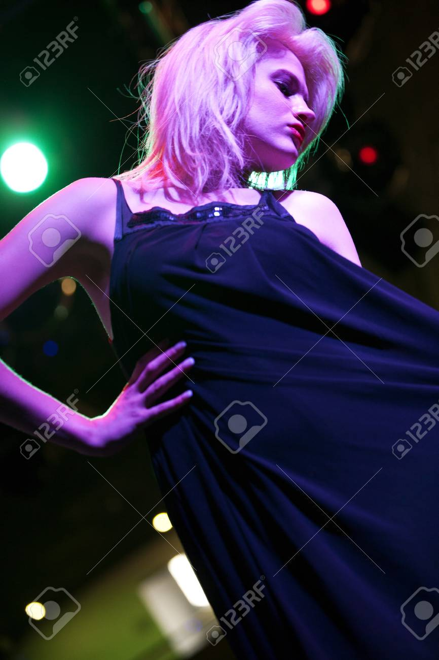 Attractive young woman dancing in a nightclub Stock Photo - 18000696