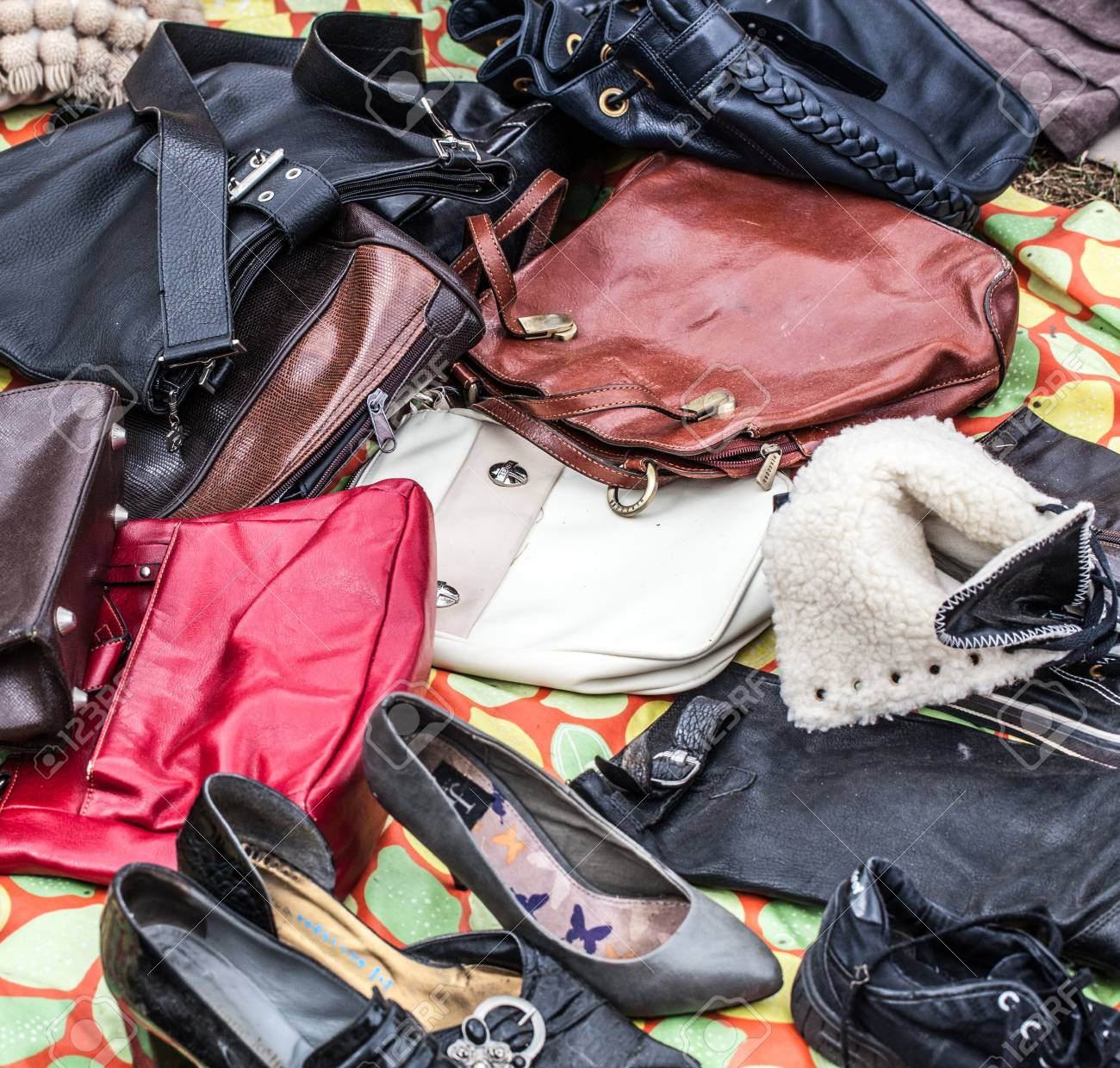 ea0b8a1c7f267 mix of second hand leather women purses and bags on sale at garage sale on  grass