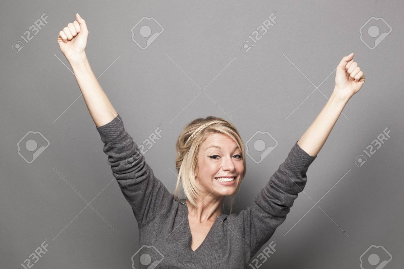 success concept - ecstatic young blonde woman winning a competition with fun body language - 52422700