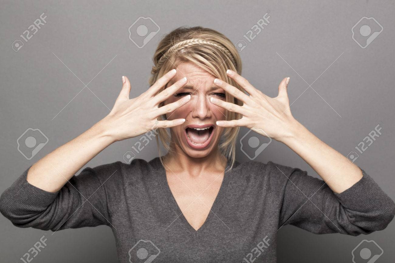 48377776-drama-queen-concept-crying-out-loud-20s-blond-girl-complaining-with-tears-and-hands-hiding-her-face--Stock-Photo
