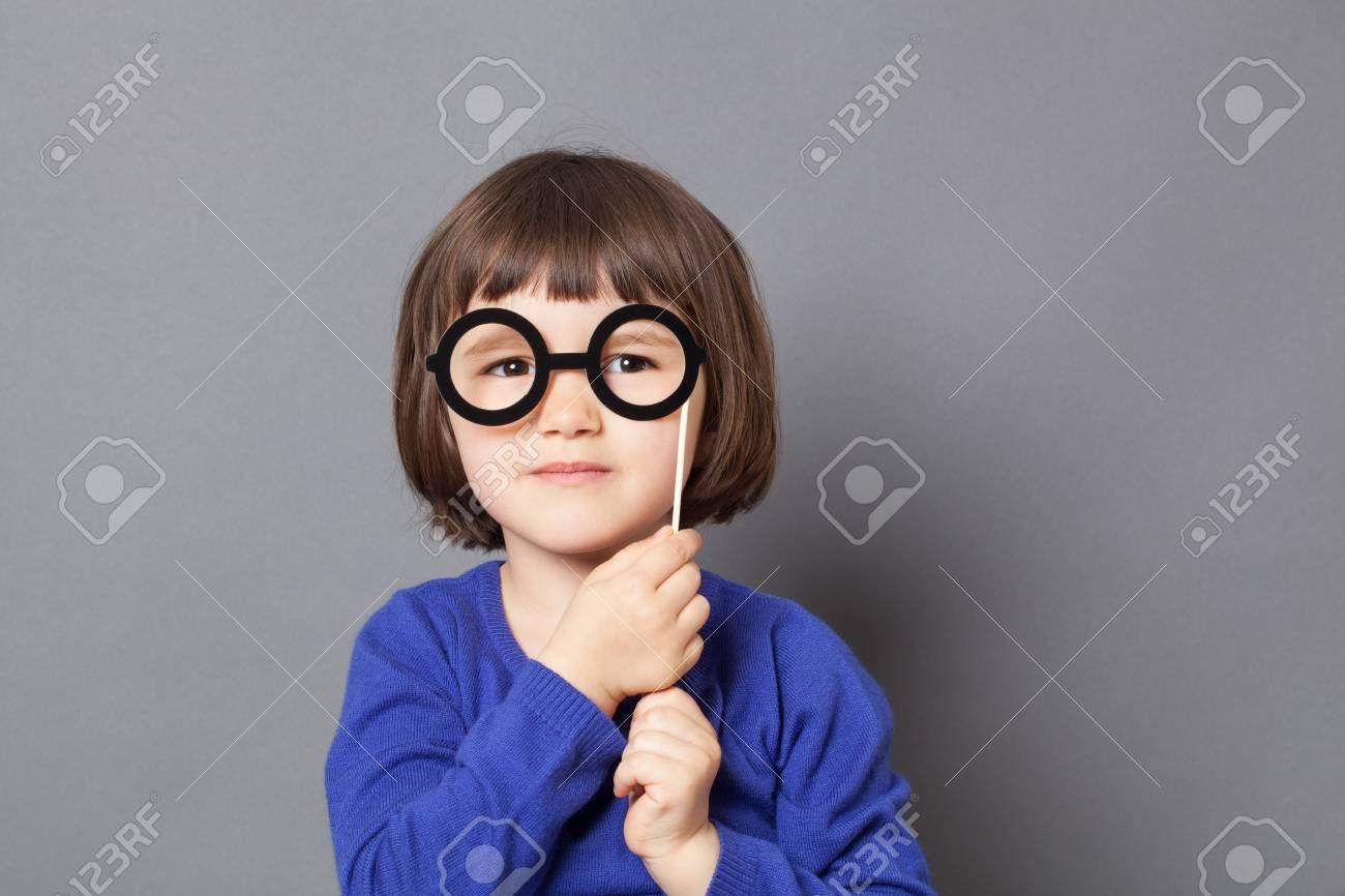 948b53950f52 fun kid glasses concept - serious preschool child holding fake black round  eyeglasses for playing like