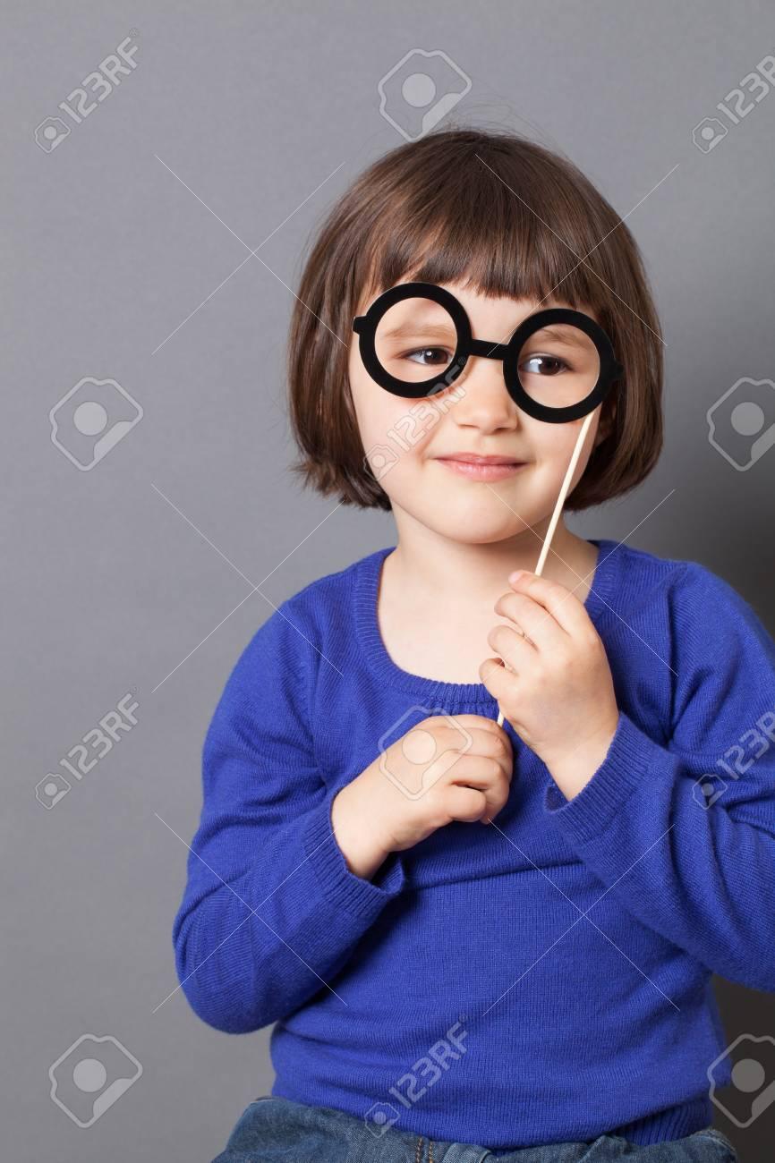 09d6504561c3 fun kid glasses concept - smiling preschool child holding fake black round  eyeglasses for playing like