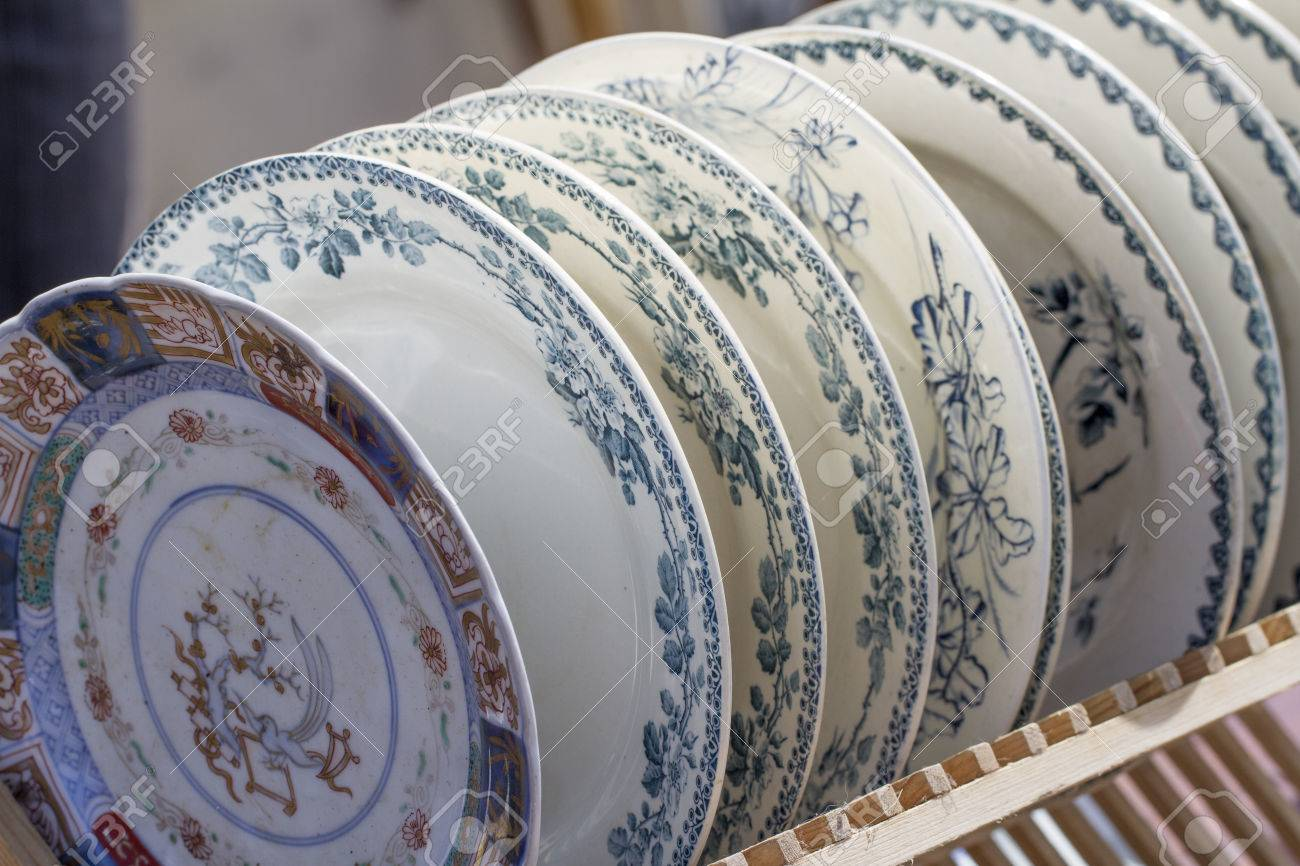 Old Plates Displayed For Sale At Second Hand Shop Stock Photo ...