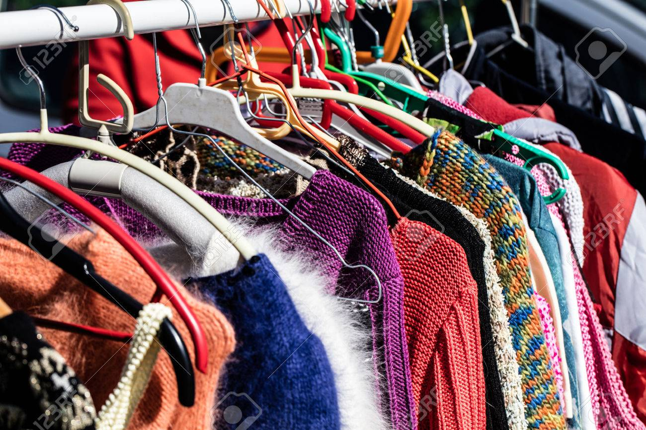 rack of fast fashion colorful women\u0027s sweaters on display for..