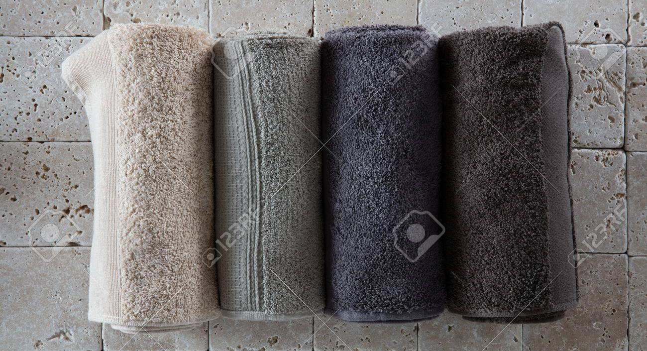 Imagens   Set Of Cotton Towels For Male Spa Made Of Four Rolled Up Beige,  Green, Grey And Natural Hues Set On Natural Beige Limestone For Bathroom ...