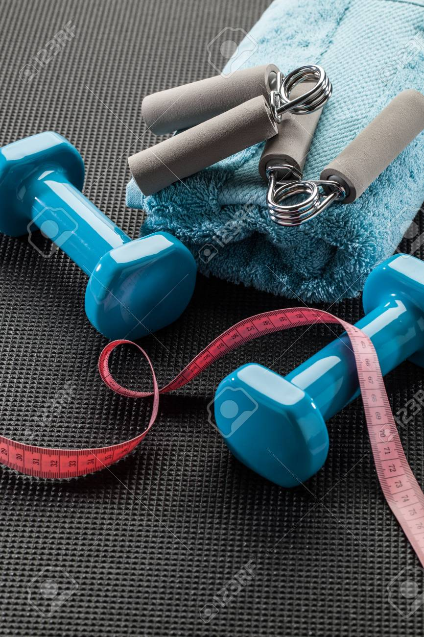 Fitness Accessories With Hand Grips And Dumbbells Set On Gym.. Stock ...