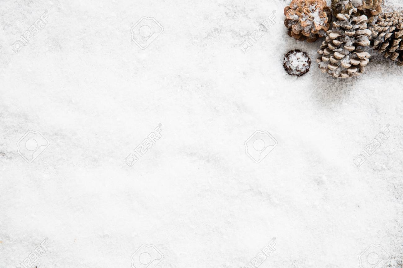 stock photo winter snowy wallpaper with frozen fir cones for white new years eve background for announcement copy space flat lay
