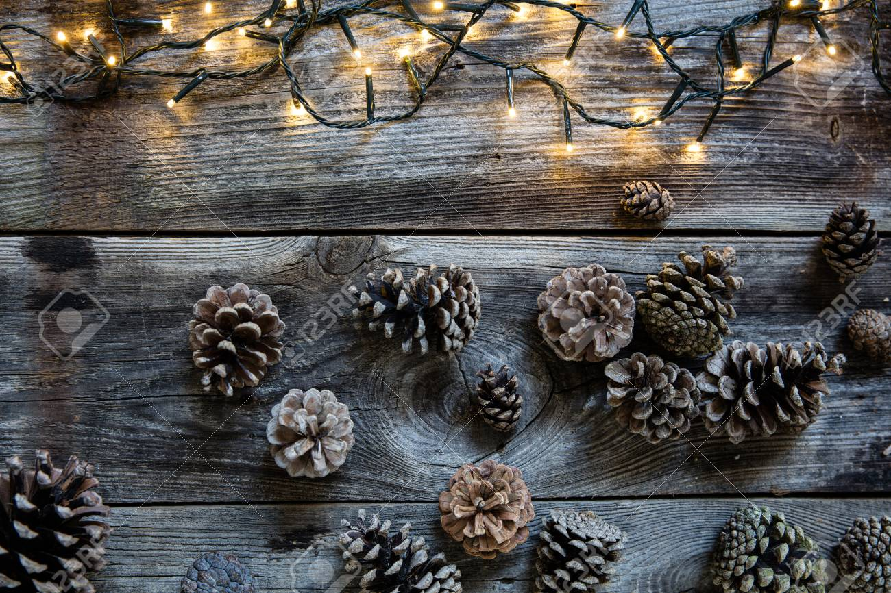 Winter Decorative Light On Old Rustic Wooden Timbers With Fir