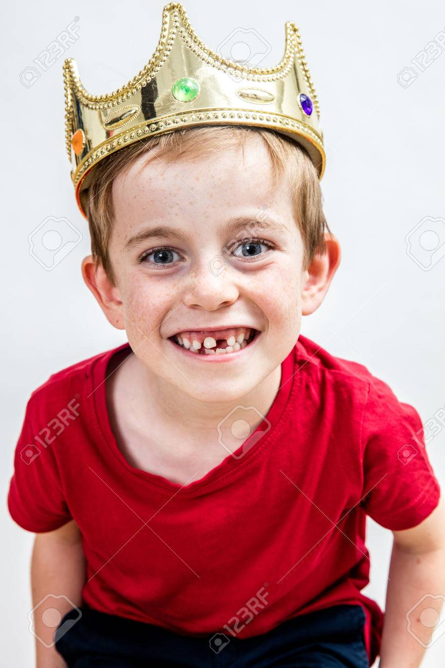 closeup of a happy beautiful 7-year old boy with a missing tooth