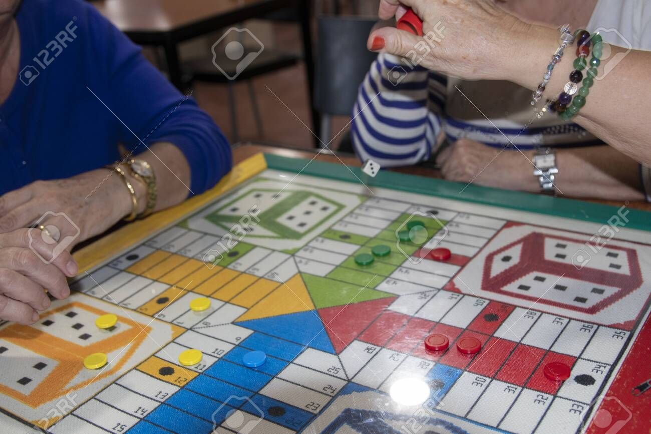 Older Women Playing Parcheesi Board Game With Square Board Stock Photo Picture And Royalty Free Image Image 135083057