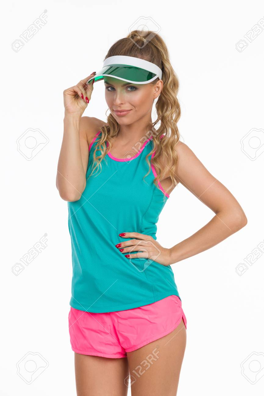 e82d2060f50353 Cheerful Beautiful Young Woman In Pink Shorts