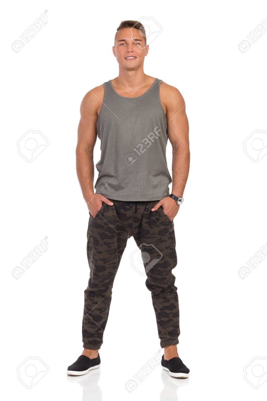 80c1b4c3f3286e Smiling Young Muscular Man In Pants With Camo