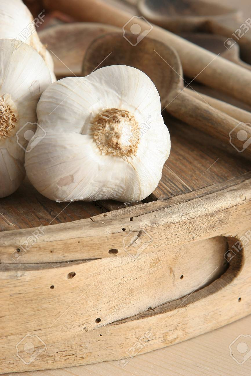 garlic and wooden cutlery Stock Photo - 13307924