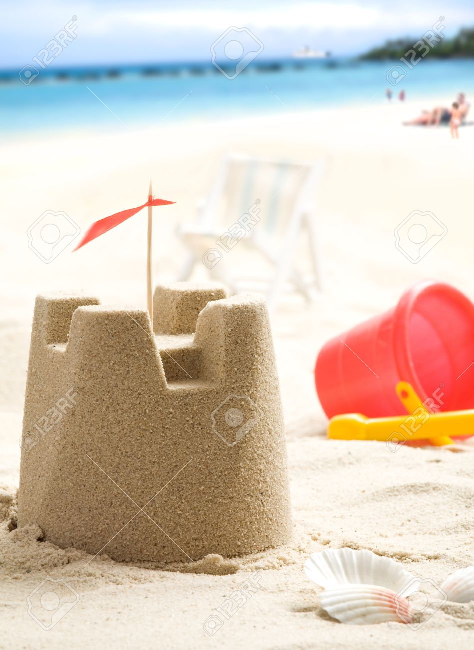 Sand castle on the beach  People and sea in background Stock Photo - 13307846