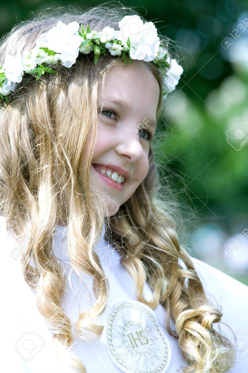 Beautiful girl in first communion uniform with ISH on chest Stock Photo - 14164317